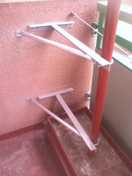 Balcony mounted brackets - twin braced Ts & concreted base.